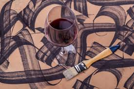 Glass of wine and brush